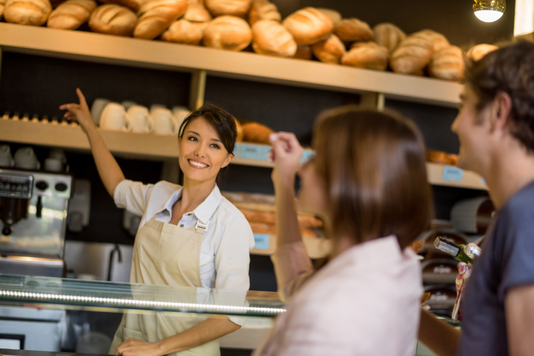 employee smiling at customers