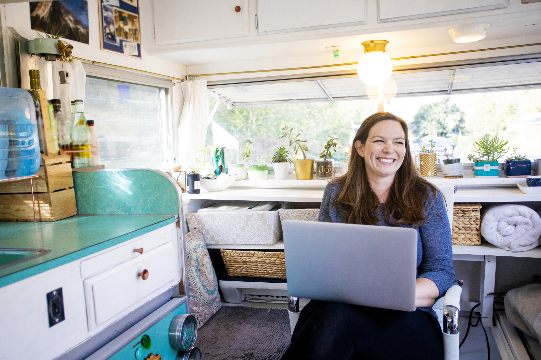Woman Laughing in Tiny Home