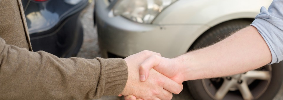 shaking hands after accident