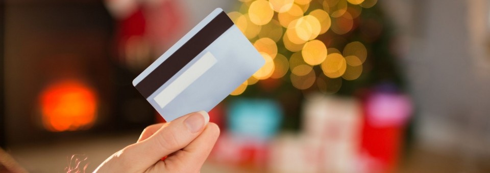 Woman Holding Credit Card during Holidays